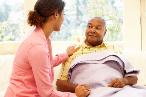 caregiver and elderly man talking